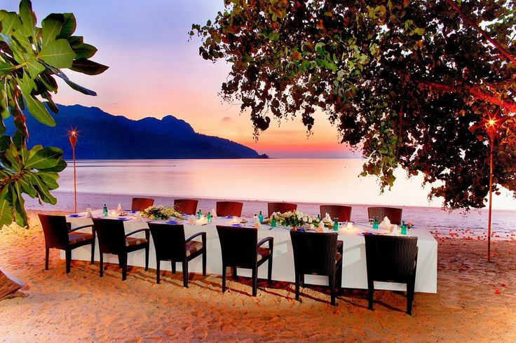 A private dinner on the beach at sunset, ready for guests staying at The Andaman, a Luxury Collection Langkawi Resort in Malaysia!