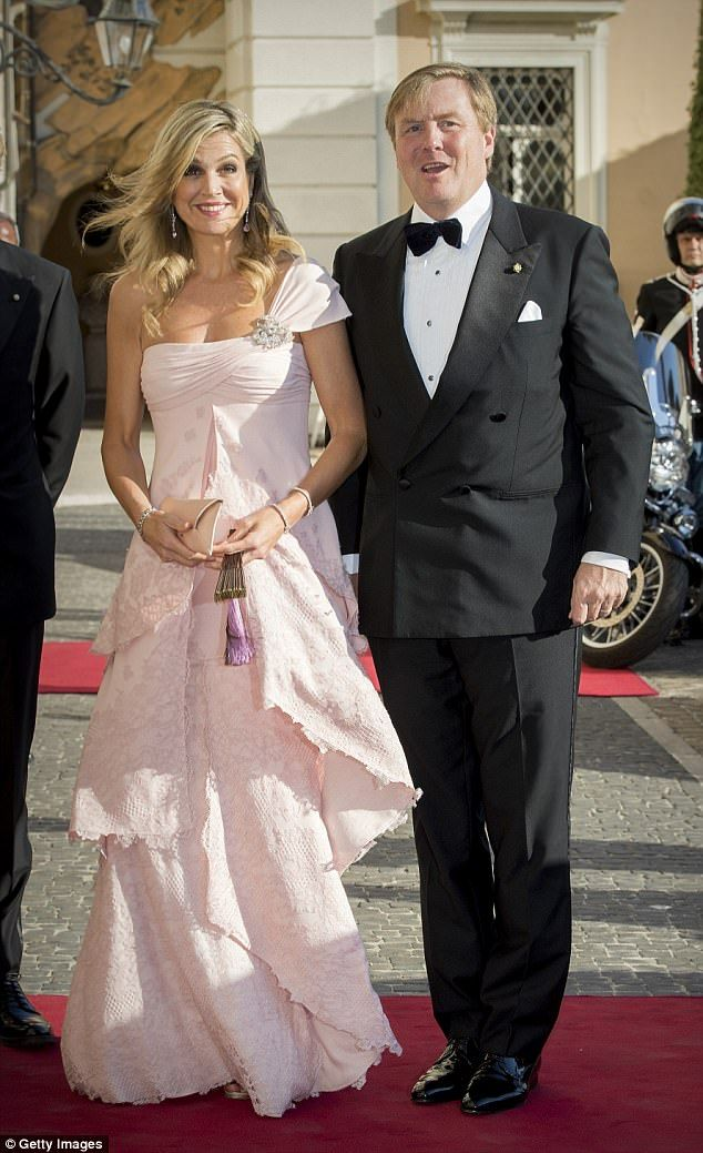 Maxima accessorised her tiered pink gown with a discreet clutch, a fan, and dazzling jewels