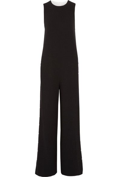 Tibi's jumpsuit is cut from two-tone crepe. This sleeveless design has a loose fit and is trimmed with sporty side snaps along the dramatic wide-leg silhouette. Wear yours with slippers, letting them pool slightly at the hem.