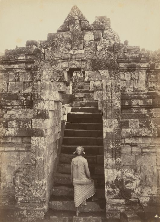 Kassian Céphas (Indonesia 1845–1912), Man climbing the front entrance to Borobudur, Central Java, 1872, albumen silver photograph, 22.2 x 16.1 cm. Collection: National Gallery of Australia.