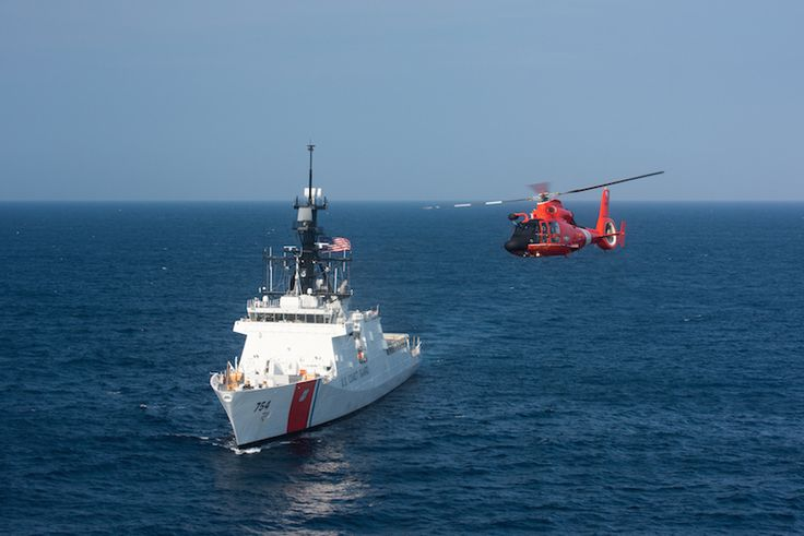 """The Coast Guard's latest 418-foot National Security Cutter, James (WSML 754), is underway in the Atlantic Ocean with an MH-65 """"Dolphin"""" helicopter, Thursday, July 30, 2015. The James is the fifth of eight planned National Security Cutters – the largest and most technologically advanced class of cutters in the Coast Guard's fleet. (U.S. Coast Guard photo by Auxiliarist David Lau)"""
