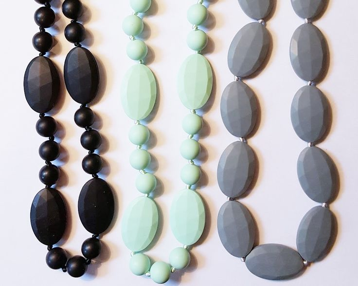 Fashionable Teething Necklace for Moms and Baby - Made of silicone (the same material as teethers), these fashion forward chew-safe bead necklaces are great for mom to wear, for her to look great, but baby can enjoy it too! They will love the designs and colors and it won't break when they tug on it. If they put it in their mouths, it is soft on babies gums and emerging teeth, non toxic, and BPA free and mom can pop it in the dishwasher or simply rinse it clean with soap and water.