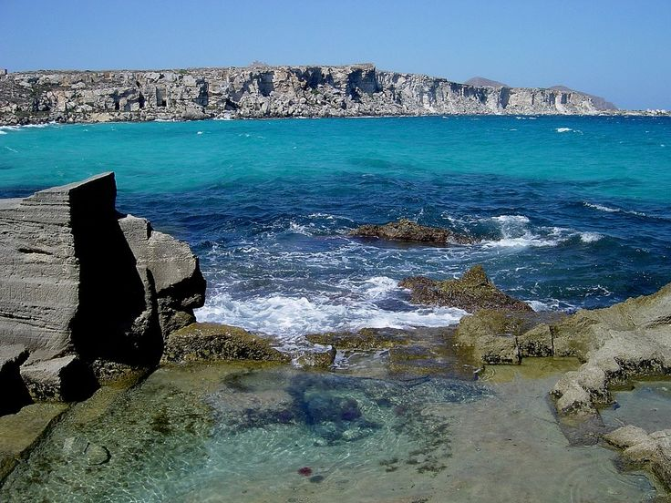 #Favignana one of #Egadi #island 10 miles from #Trapani. A paradise of #colours in #Sicily. Here the rocky shore of #Cala Rossa. Our #B&B Belveliero is in #Trapani port, in front of hidrofloils, are you ready to go to #Egadi islands? bebtrapanilveliero.it