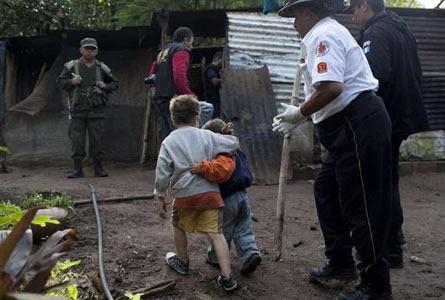 Four children hide as family killed by gunmen
