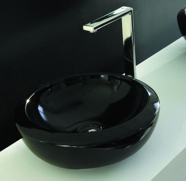 Помните о том, что маленькая черная раковина – отличный выбор, если вы задумали совсем необычный дизайн раковины, подходящий цвет просто необходим. Белый классический цвет не сможет передать всю задумку голубого ручейка, ведущему к сливу, в отличие от бирюзового или голубого умывальника. http://santehnika-tut.ru/rakoviny/rakoviny-chernogo-cveta/  #санузел #плитка #сантехника