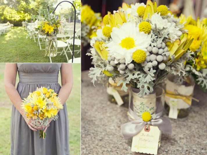Mason jar flower vases, affixed with yellow flowers...  hanging from a metal flower stake.  Neat idea to align the aisle...  An easy DIY project...