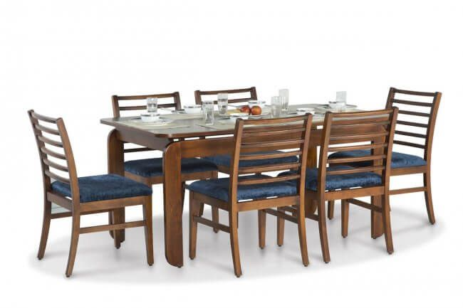 This Royal Dining Table Set from Ekbote Furniture is made with high-quality beech wood an commercial ply. This comes with one year warranty and after sales service.