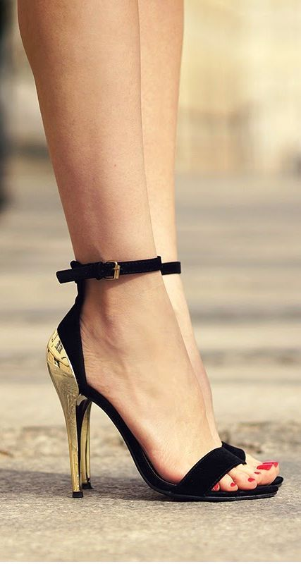 Gorgeous golden heel black strap sandals
