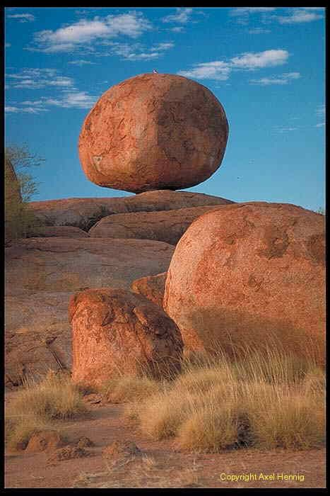 Devils Marble, Australia-- These are huge round boulders out in the middle of the dessert. It truly is an unbelievable sight to see them precariously balancing on top of one another. Sometimes it seems like gravity doesn't exist in that area.