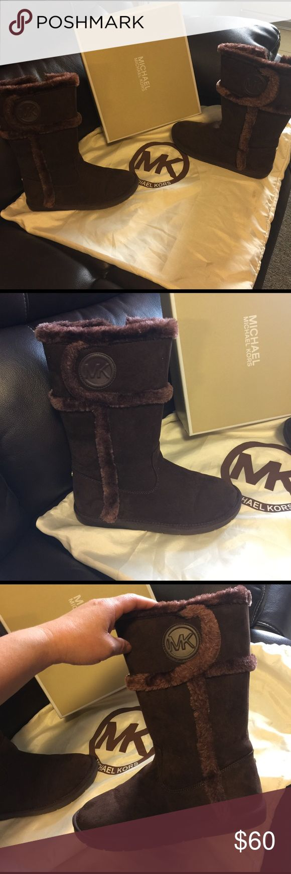 Authentic MK brown boots 7/ 71/2 Authentic MK boots size 7 7 1/2 perfect condition use two times this is size 5 girls run big fits 7 and 71/2 guarantee im 8 that's why im selling them, I love this, color is brown  litle mk on back boot like new in box don't miss this one beautiful you will love MICHAEL Michael Kors Shoes Ankle Boots & Booties