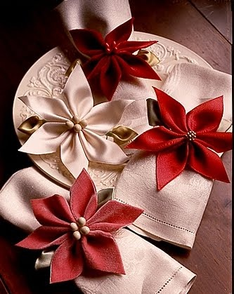 Instead of putting the poinsettia inspired ornaments on a tree, you can tie them with ribbon around your napkin to make the perfect napkin ring/holder.