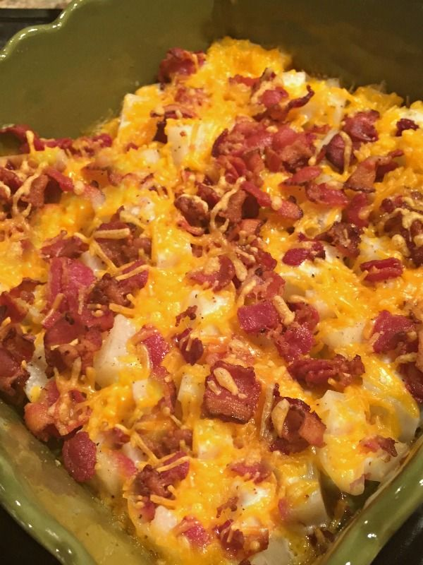 Cheesy Ranch Potatoes with bacon. This is a super easy side dish and the whole family raved about it! What's not to love, ranch, potatoes, cheese, and bacon!