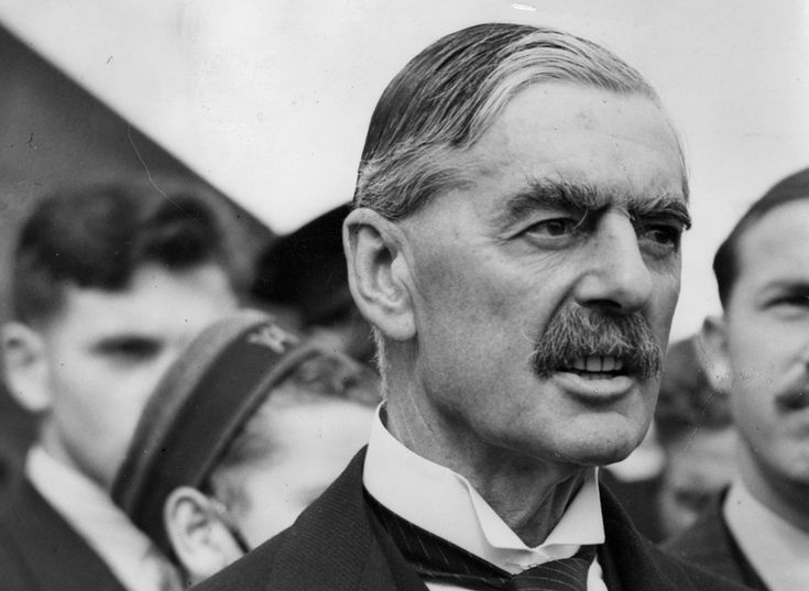 British Premier Sir Neville Chamberlain, on his return from talks with Hitler in Germany, at Heston airfield, London, England, on September 24, 1938. Chamberlain brought with him a terms of the plan later to be called the Munich Agreement, which, in an act of appeasment, allowed Germany to annex Czechoslovakia's Sudetenland.