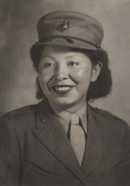 """Private Minnie Spotted-Wolf of Heart Butte, Montana, enlisted in the Marine Corps Women's Reserve in July 1943. She was the first female American Indian to enroll in the Corps. Minnie had worked on her father's ranch doing such chores as cutting fence posts, driving a two-ton truck, and breaking horses. Her comment on Marine boot camp """"Hard but not too hard."""""""