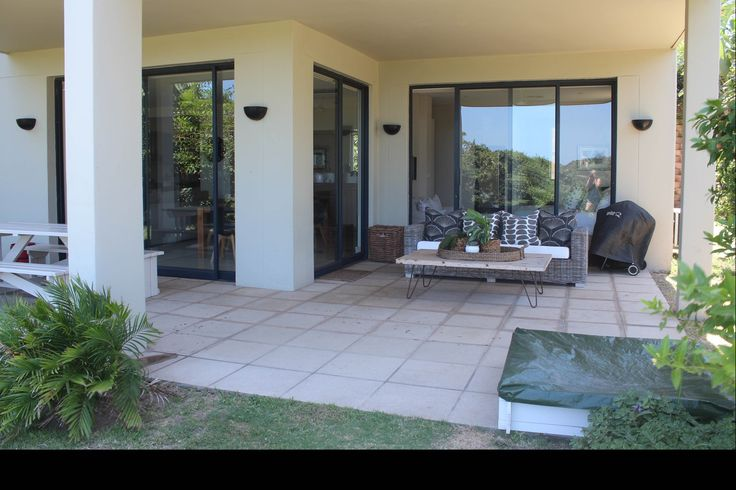 2 Sandwood Hills, Salt Rock, KZN North Coast. Spacious and comfortable ground floor 3 bedroom, 2 5 bathroom apartment in a secure eco-friendly Salt Rock residential estate. Patio overlooks indigenous forest and has distant sea views. Open plan lounge, dining room, kitchen, double lock-up garage.