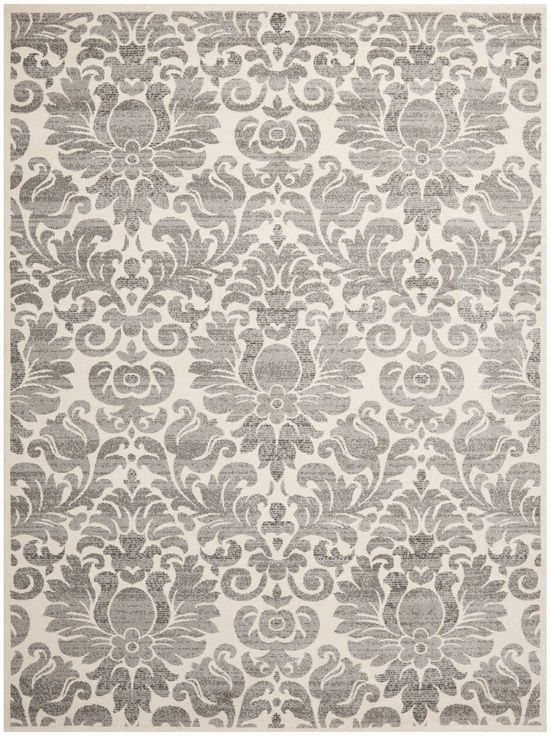 Create tranquility in your home with this ivory/gray rug. The design blends contemporary colors with a classic damask pattern for a modern style that matches most decors. The thick pile is plush under