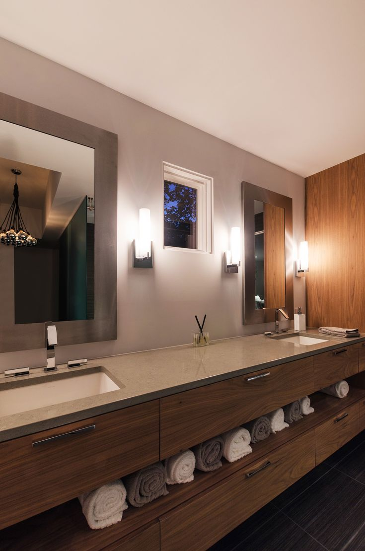Gallery For Website Gorgeous modern bathroom design plemented by Tube Vanity Wall Sconces Tales Suspension reflected in the mirror