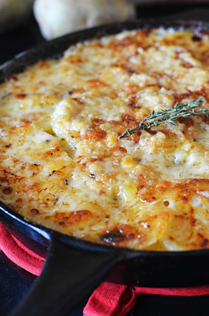 Skillet Scalloped Potatoes!  This super cheesy side dish makes my heart flutter. | hostthetoast.com