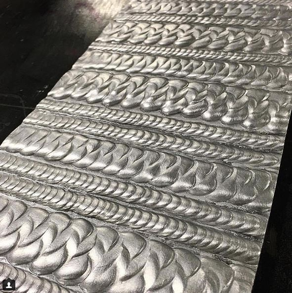 Amazing example of a welder's skill. I'm reminded of how a cake decorator will put in hours of practice with a piping bag, or a calligrapher with his pen.
