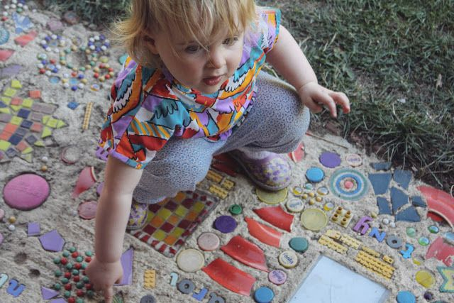 I love the idea of mosaics that we could make with the kids, either for mounting on the fence or walking on. This link has more mosaic ideas.