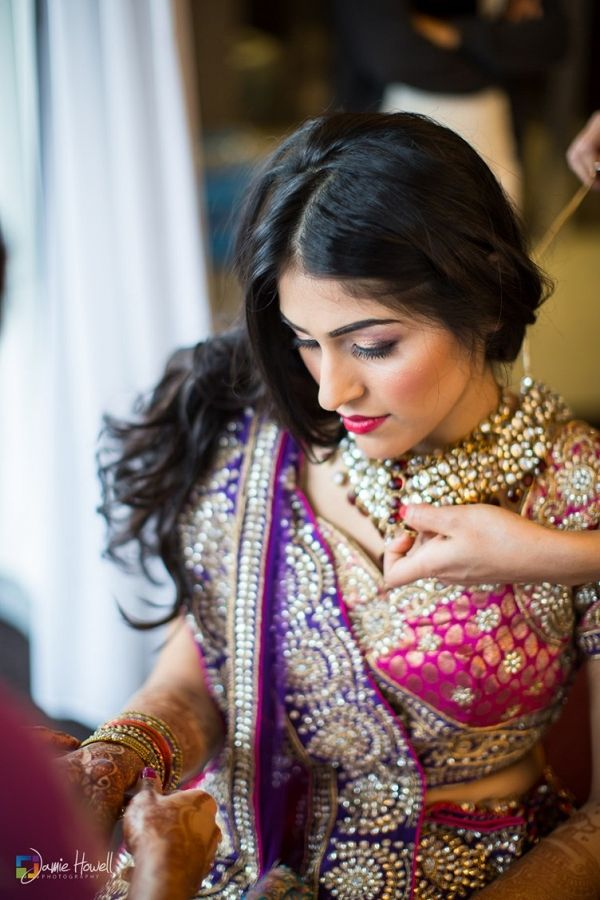 A pink and purple Gujarati Indian wedding in Georgia with elegant white decoration.