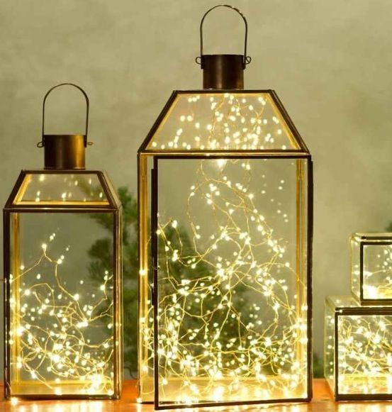Glass lanterns with lights inside.//