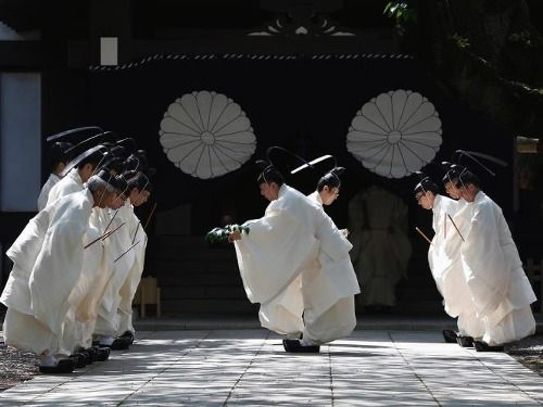 Shinto priests of the Yasukuni santuary. Tokio, Japan.      REUTERS - Yuya Shino.