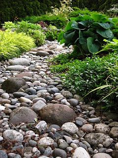 34 best images about dry river bed on pinterest gardens for Laying river rock