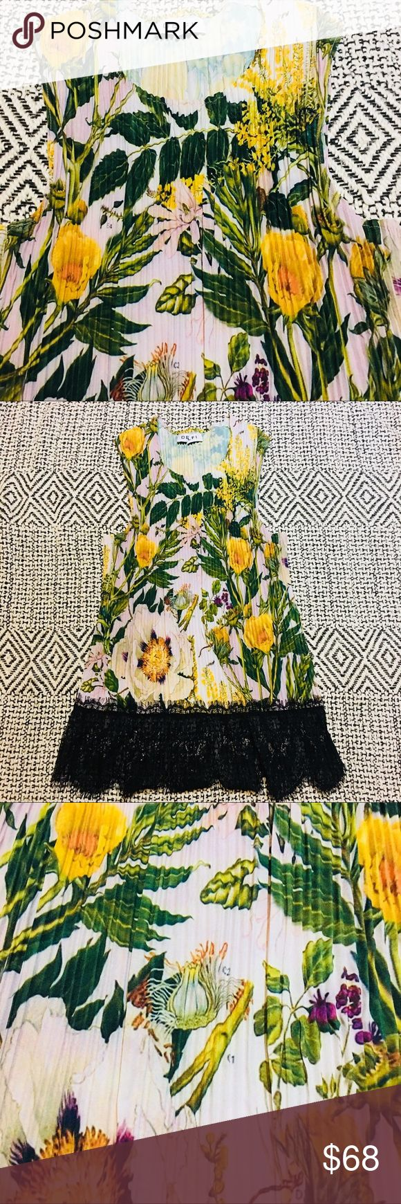 Floral Delfi Blouse Delphi @ Anthropologie floral accordion blouse with beautiful lace trim.   **Please note: This item is from a Sample Sale. Tags may be cut, damaged or missing (measurements are included when sizing is not). All sample sale items are NWOT.** Anthropologie Tops Blouses