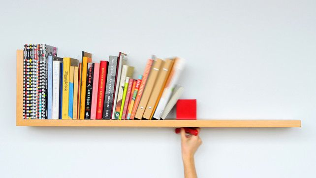 The Sliding Lock Shelf. Great idea when you don't have enough books (yet) to fill your new shelf.