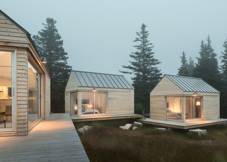Trio of wooden cabins forms Little House on the Ferry in rural Maine