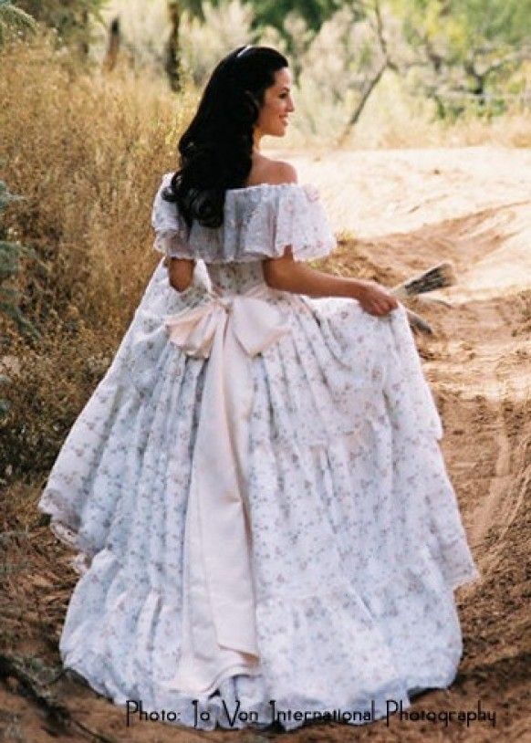 Such a gorgeous gown to be in the dirt! Deserves a nicer setting. It must be…