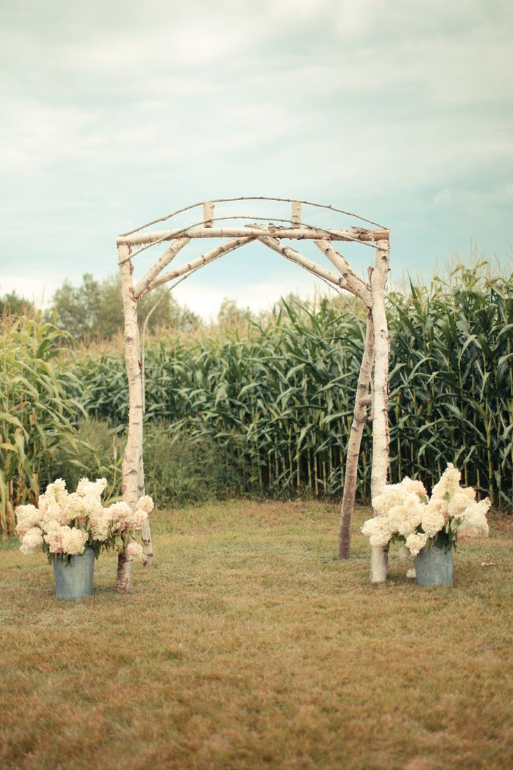 Simple Rustic Arch Juxtaposed With Lush Country Chic Florals Aisle Style Pinterest