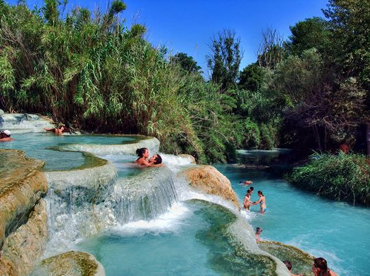 Terme di Saturnia are a group of springs in Italy that have a series of cascades at 37° with dozens of beautiful pools at different levels..