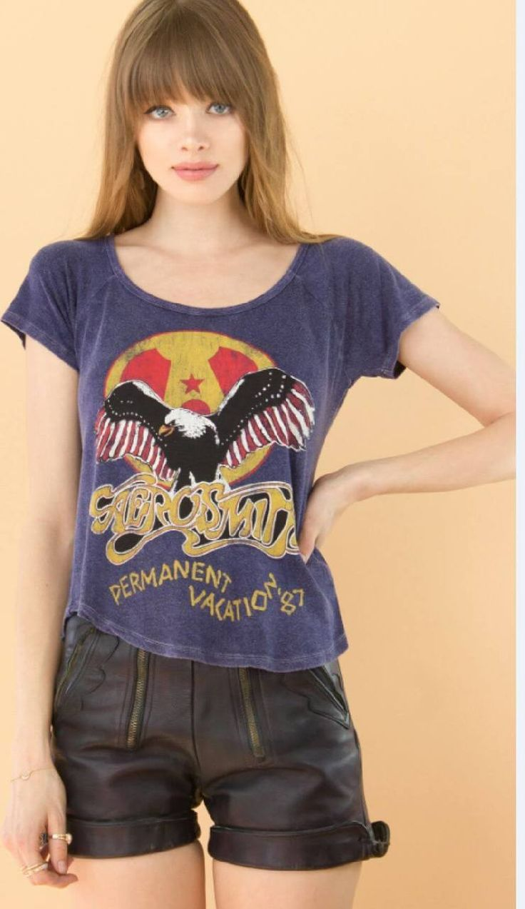 Our women's vintage Aerosmith concert tshirt is from the band's 1987 leg of their Permanent Vacation Tour which was performed to promote their most recent album, at the time, also called Permanent Vacation. The album features some of Aerosmith's biggest hits, including Rag Doll, Dude (Looks Like a Lady) and Angel. Our blue tee is made from a rayon spandex blend and spotlights Aerosmith's bald eagle logo on top of Permanent Vacation '87. #aerosmith #bandtees #rockerrags