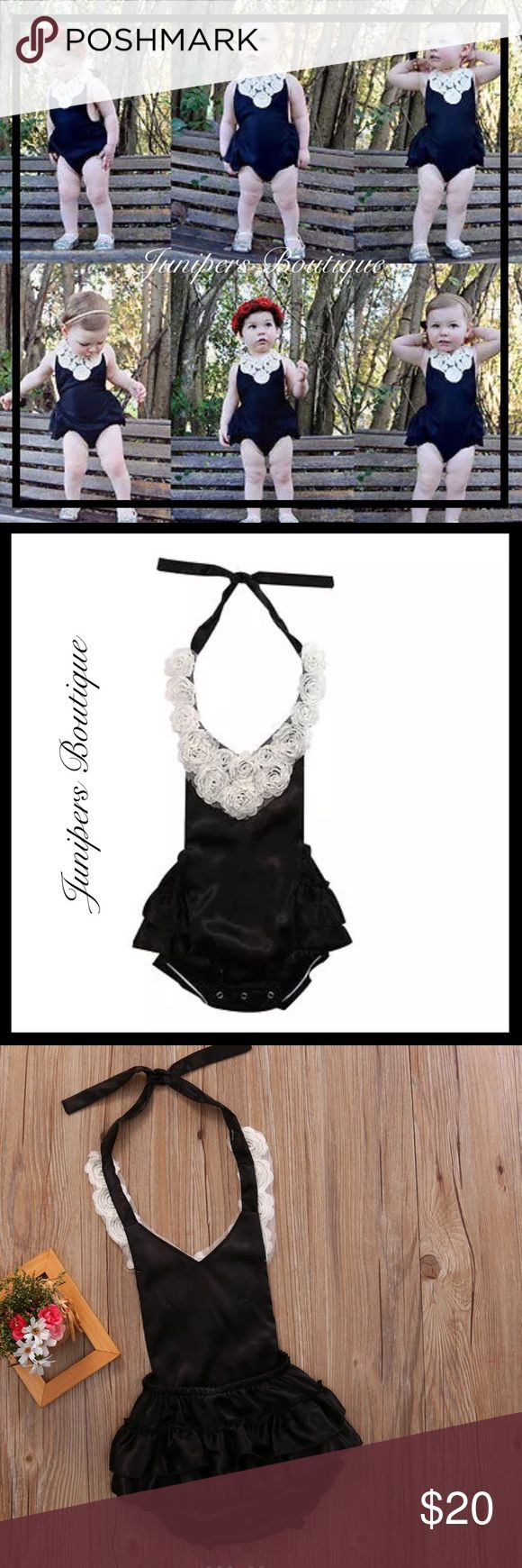 Boutique Baby Girl Black Satin Romper Beautiful baby girl black satin halter style Romper with white Rosette flowers to top and black satin ruffles to back side. Snaps at bottom. One Pieces Bodysuits