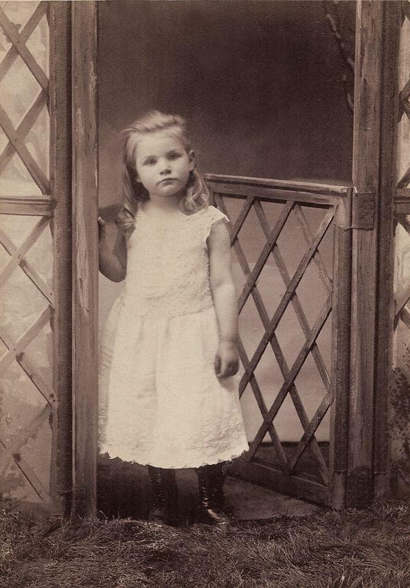 +~+~ Antique Photograph ~+~+  Darling girl posing by portrait studio gate.  Arkansas City, Kansas 1887.
