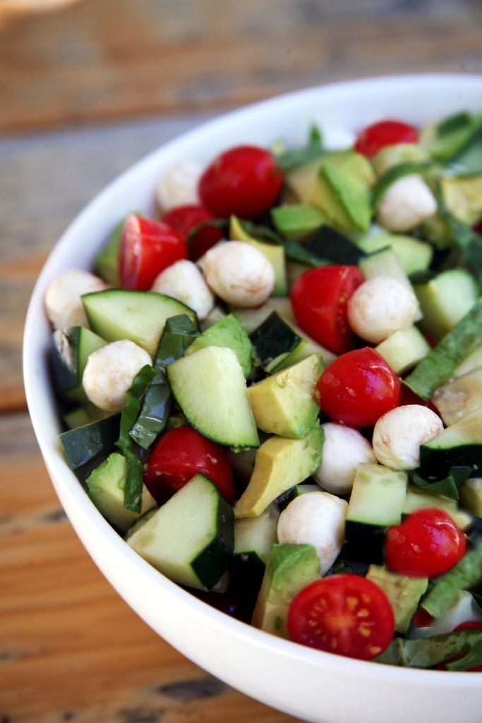Give classic caprese a summery spin with the addition of cubed avocado and cucumber.  Image Source: POPSUGA...