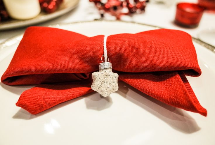 Red bow made from napkin. Christmas diy decoration