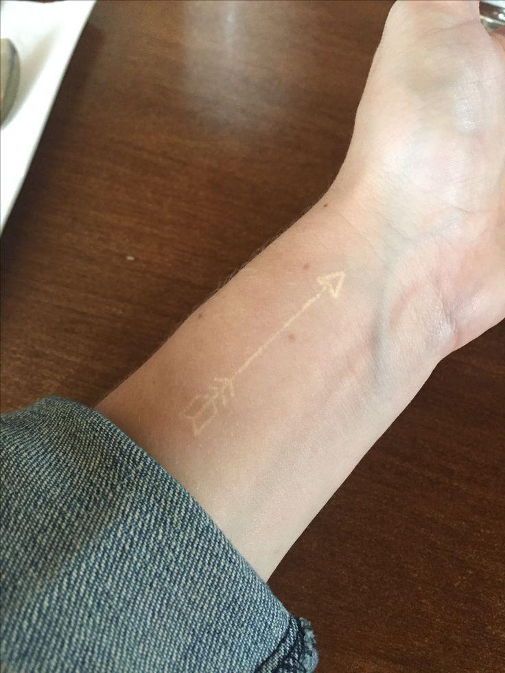White arrow tattoo