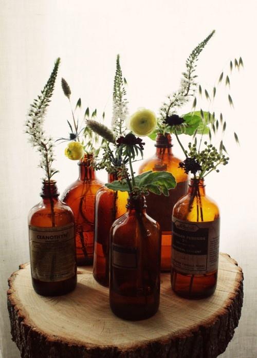 amber bottles. or just wine/beer bottle vases!