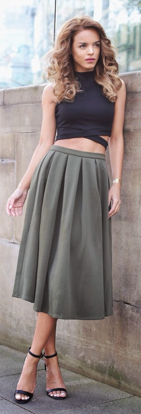 Classy pleated neutral skirt that would coordinate with a variety of tops, by Nada Adellè