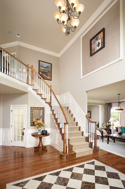 Toll Brothers - Hopewell Foyer:  good way to treat the wall space above entry to living room with framed out art