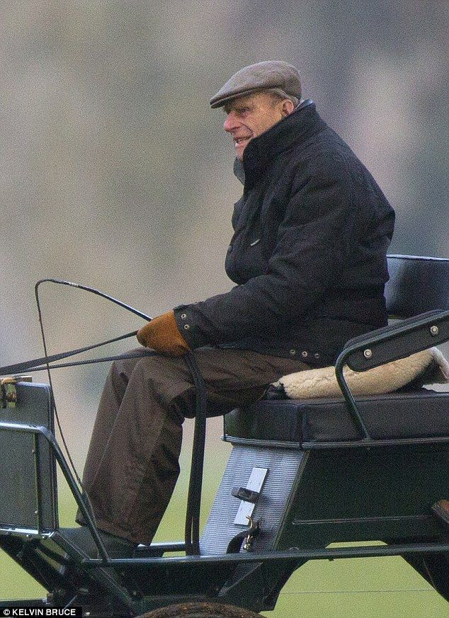 Wrapped up: The royal donned a padded jacket, gloves and a flat cap for the outing today...