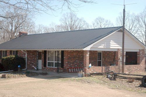 Light gray metal roof on brick house brick ranch home for Ranch style metal homes