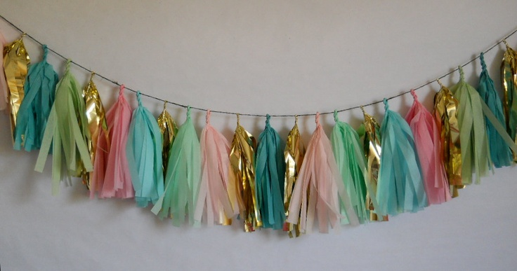 etsy $38 - StudioMucci  the other 17 tissue tassels are featured in aquamarine, light pink, dark pink, cool mint, willow, and Caribbean blue. Each tissue tassel is made of post consumer recycled tissue paper. And all tassels for this garland are lovingly hand-cut but yours truly.