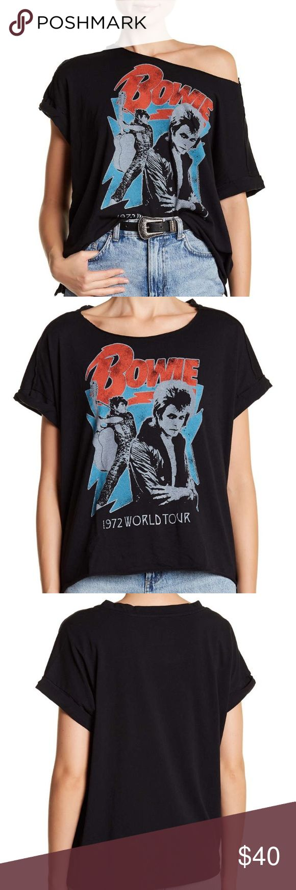 NWT Distressed David Bowie Tshirt New with tags Tshirt, still in plastic from manufacturer. David Bowie tee. Black, thin and soft fabric. The short is intentionally distressed and made to look vintage. Size small. In fished crew neck. Slouchy on shoulder. By Bravado. Retail is over $60. Bravado Tops Tees - Short Sleeve