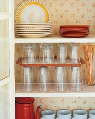 A simple tray inside of your cabinets create a make shift shelve and will provide some much needed storage - See more at: http://diyhshp.blogspot.co.nz/2013/04/16-ways-to-add-more-storage-to-any-home.html#sthash.kJktJmTH.dpuf