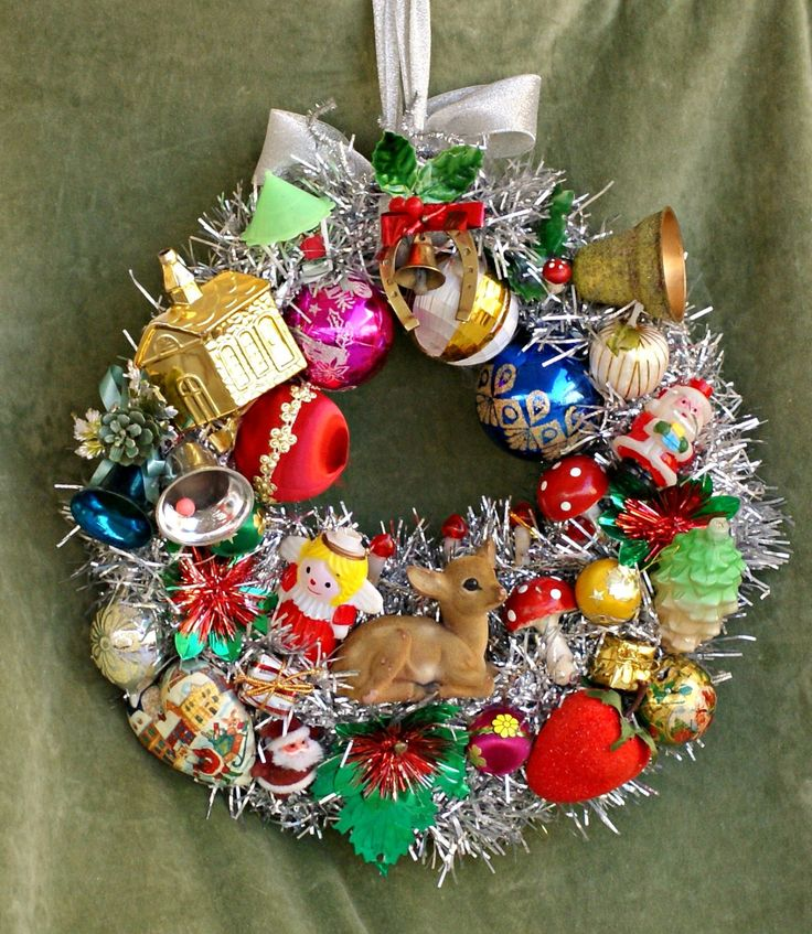 A whimisical Christmas wreath  made of vintage Christmas ornaments, celluloid ornaments, spun cotton mushrooms and a wonderful flocked deer. It's just wonderful for your Christmas door decor, nursery decor. It 'll amaze you