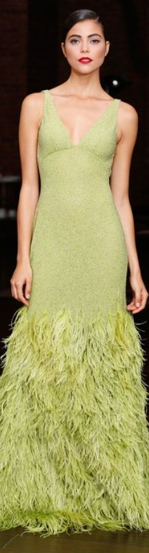 VERDE LIMA - an empire waist that drops into a flowing gown ending in feathery splendor. This light lime-green gown is just delightful.